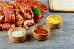 Fresh raw pork shoulder chop with spices Fresh pork ribs, meat marinated and prepared. Fresh pork ribs, meat marinated and prepared shoulder chop with spices Stock Images