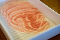 Fresh raw pork slice for grill. Serving on white tray Royalty Free Stock Photo