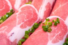 Fresh raw pork slices. Close up fresh raw pork slices for shabu or bbq Stock Photo