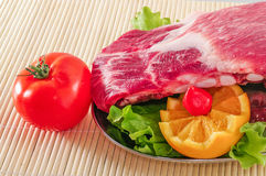 Fresh raw pork spare ribs decorated with vegetables and clipping path Royalty Free Stock Photography