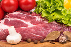 Fresh raw pork. Raw pork with spices and vegetables on a cutting board close-up Stock Image