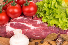 Fresh raw pork. Raw pork with spices and vegetables on a cutting board close-up Stock Photo