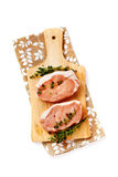 Fresh raw pork steaks on cutting board Royalty Free Stock Photography