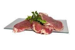 Fresh raw pork. On a white background Royalty Free Stock Photo