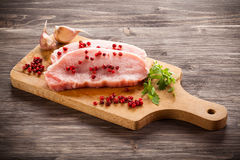 Fresh raw pork. On wooden background Royalty Free Stock Photos