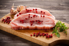 Fresh raw pork. On wooden background Stock Photography