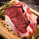 Fresh raw pork. On wooden background Stock Photo