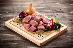 Fresh raw pork. On wooden background Stock Images