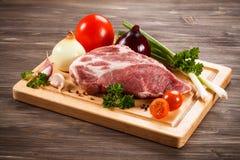 Fresh raw pork. On wooden background Royalty Free Stock Photo