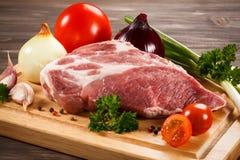 Fresh raw pork. On wooden background Royalty Free Stock Image