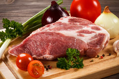 Fresh raw pork. On wooden background Royalty Free Stock Photography