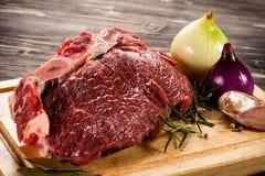 Fresh raw pork. On wooden background Stock Photos