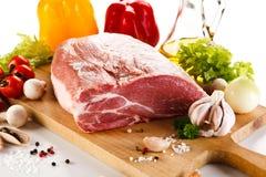Fresh raw pork. On wooden background Royalty Free Stock Photos