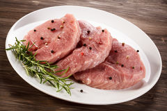 Fresh raw pork. On wooden background Stock Photos