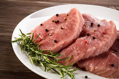 Fresh raw pork. On wooden background Royalty Free Stock Image
