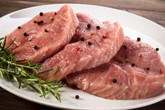 Fresh raw pork. On wooden background Stock Image