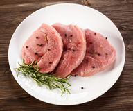 Fresh raw pork. On wooden background Royalty Free Stock Photo