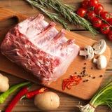 Fresh raw pork. Raw pork on the wooden board Royalty Free Stock Photography