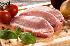 Fresh raw pork. On a wooden board Stock Photography