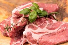 Fresh raw pork. On a wooden mango board royalty free stock photo