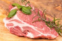Fresh raw pork. On a wooden mango board Stock Photos