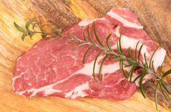 Fresh raw pork. On a wooden mango board Royalty Free Stock Photography