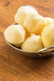 Fresh raw potato. Es in bowl  on table. Selective focus. Rustic style Royalty Free Stock Photo