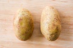 Fresh raw potato on wooden royalty free stock images