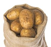A fresh raw potatoes in a sack Stock Photos