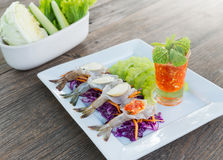 Fresh Raw Prawn In Spicy Fish Sauce. On wood table Royalty Free Stock Image