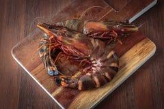 Fresh raw prawns. Delicious fresh prawns on wooden chopping board Stock Photography