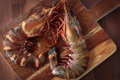 Fresh raw prawns. Delicious fresh prawns on wooden chopping board Stock Photo