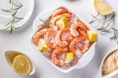 Fresh raw prawns. On ice with lemon Royalty Free Stock Photos