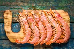 Fresh raw prawns on a wooden cutting board. On rustic table Stock Photography