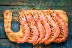 Fresh raw prawns on a wooden cutting board Stock Photography