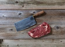 Prime Beef Steak with Butcher Knife on rustic wood Stock Images