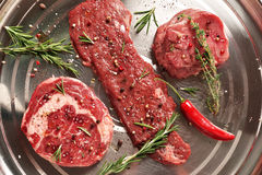 Fresh raw Prime Black Angus beef steaks on steel background Royalty Free Stock Photos