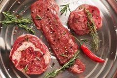 Fresh raw Prime Black Angus beef steaks on steel background. Rib Eye, Skirt, Tenderloin Royalty Free Stock Photos