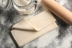 Fresh raw puff dough. On table Royalty Free Stock Photography
