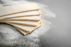 Fresh raw puff dough. On table Stock Images
