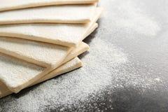 Fresh raw puff dough. On table Royalty Free Stock Photos