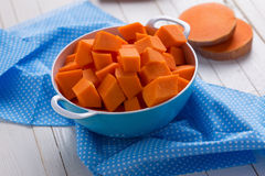Fresh raw pumpkin. In bowl on wooden background. Selective focus Stock Images