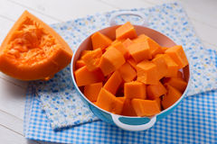 Fresh raw pumpkin. In bowl on wooden background. Selective focus Stock Image