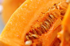 Fresh raw pumpkin. Closeup on wooden background Royalty Free Stock Image