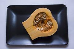 Fresh raw pumpkin. Pumpkin, rich of vitamins vegetable under contrast lightning Royalty Free Stock Images