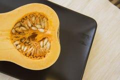 Fresh raw pumpkin. Pumpkin, rich of vitamins vegetable under contrast lightning Stock Photography
