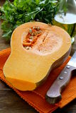 Fresh raw pumpkin. Sliced on a wooden table Royalty Free Stock Photo