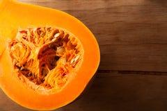 Fresh raw pumpkin on wood desk. Food ingredients. Vegetables Stock Photos