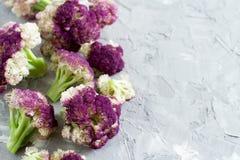 Fresh raw purple cauliflower. On a grey  board close up Stock Photography