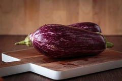 Fresh raw purple eggplants. For an healthy meal Stock Photo